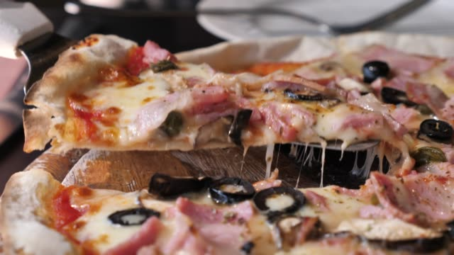slice of pizza - black olive stock videos & royalty-free footage
