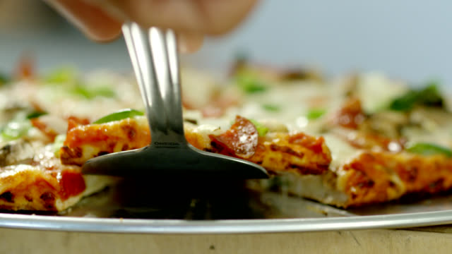 slice of pizza - green bell pepper stock videos & royalty-free footage