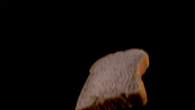 slice whole wheat bread drop on slow motion - loaf of bread stock videos and b-roll footage