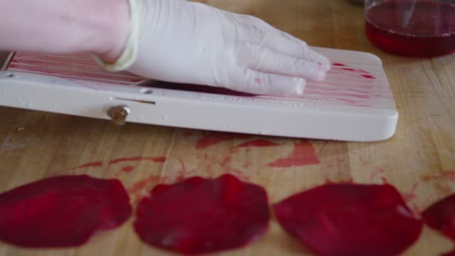 sliced ??beet with red wine in seattle - beet stock videos & royalty-free footage