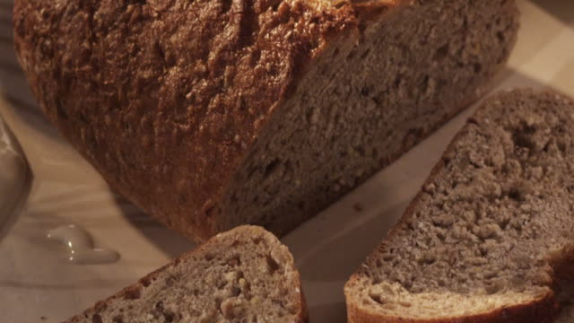 cu pan slo mo sliced bread laying out on surface / los angeles, california, united states - crumb stock videos and b-roll footage