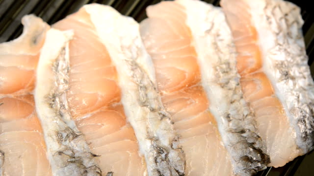 sliced fish seabass on tray for shabu and sukiyaki - filleted stock videos & royalty-free footage