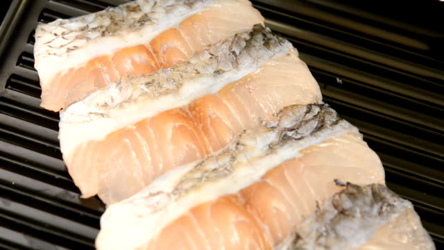 sliced fish seabass on tray for shabu and sukiyaki - trout stock videos and b-roll footage