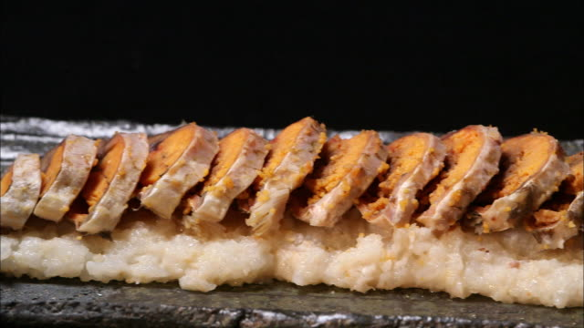 sliced funazushi (fermented carp) sushi in shiga prefecture, japan - fermenting stock videos and b-roll footage
