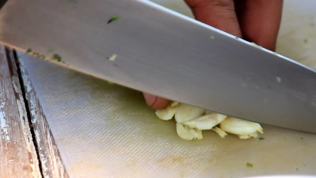 sliced garlic - obscured face stock videos and b-roll footage