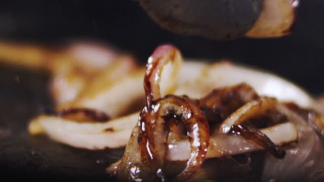 sliced onion being cooked - cast iron stock videos and b-roll footage