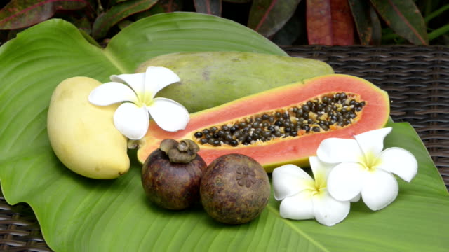 sliced papaya, mango and mangosteen fruit - ko samui stock videos & royalty-free footage