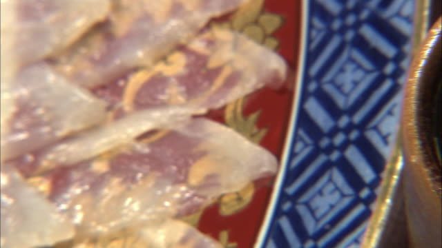 Sliced Raw Pufferfish Fillets And Hot Sake