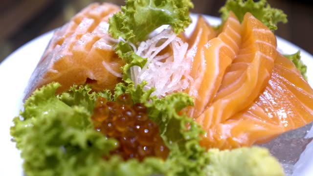 sliced salmon sashimi - wasabi stock videos and b-roll footage