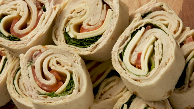 sliced turkey meat and cheese wrap sandwich - rolled up stock videos & royalty-free footage