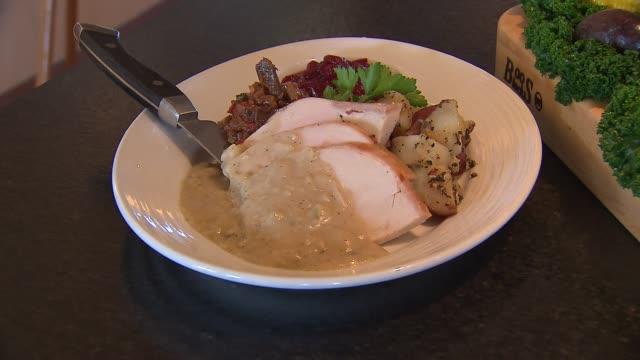 sliced turkey with cranberries and potatoes at pinstripes in chicago on nov 20 2014 - thanksgiving plate stock videos & royalty-free footage