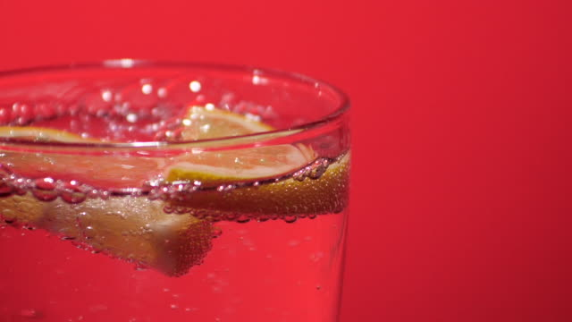 slices of lemon in water, soda, tonic, gin - slow motion - cachaça stock videos & royalty-free footage