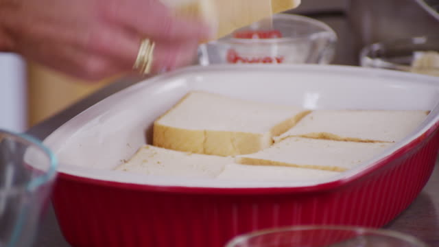slices of white bread are placed in a baking dish. - white bread stock videos and b-roll footage