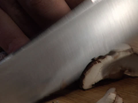 slicing a brown mushroom - unknown gender stock videos & royalty-free footage