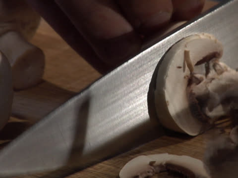 slicing a button mushroom - unknown gender stock videos & royalty-free footage