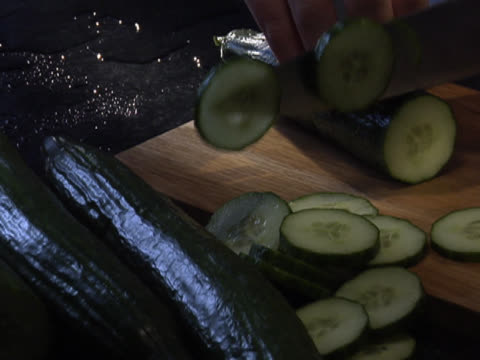 slicing a cucumber - unknown gender stock videos & royalty-free footage
