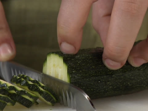 slicing a freshly washed zucchini - unknown gender stock videos & royalty-free footage