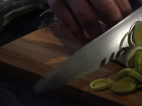 slicing a leek - unknown gender stock videos & royalty-free footage