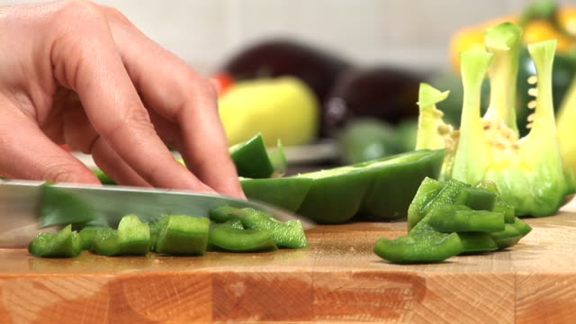 hd: slicing a pepper - chopped food stock videos and b-roll footage