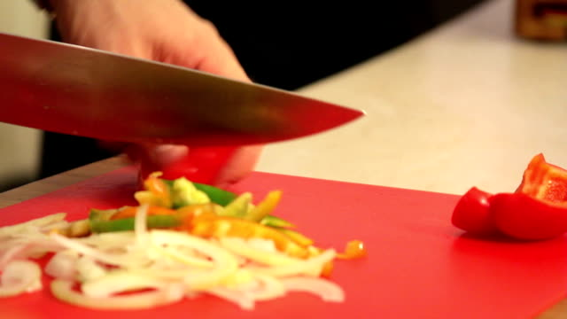 slicing a pepper - red bell pepper stock videos & royalty-free footage