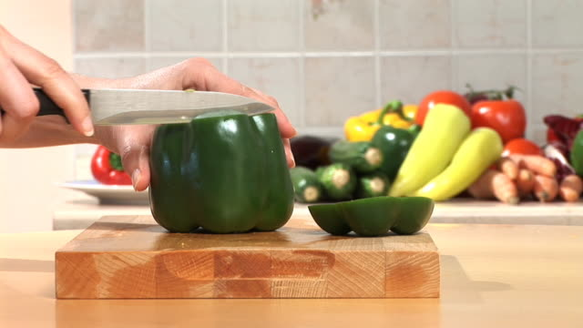 hd: slicing a pepper - green bell pepper stock videos & royalty-free footage