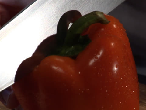 slicing a red bell pepper in half - unknown gender stock videos & royalty-free footage