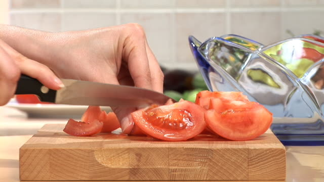 hd: slicing a tomato - chopped food stock videos and b-roll footage