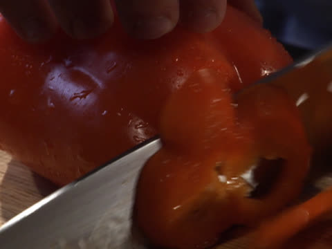 slicing a whole red bell pepper into rings - unknown gender stock videos & royalty-free footage