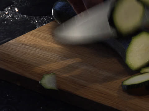 slicing a zucchini - unknown gender stock videos & royalty-free footage