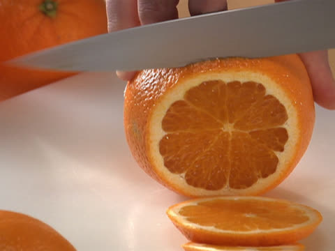 slicing an orange - unknown gender stock videos & royalty-free footage