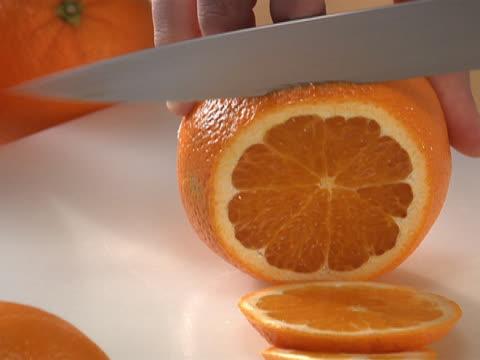 vídeos y material grabado en eventos de stock de slicing an orange - unknown gender