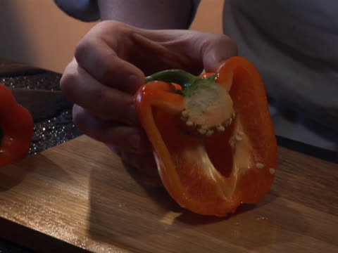 slicing and deseeding a red bell pepper - unknown gender stock videos & royalty-free footage