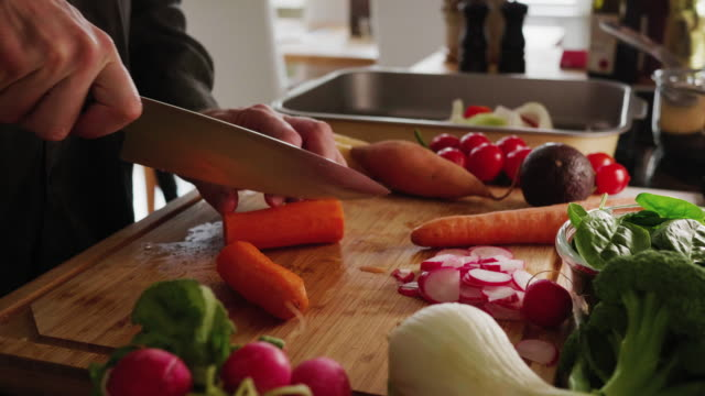 slicing carrot - chopping stock videos & royalty-free footage
