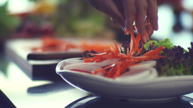 slicing carrot - cutting stock videos & royalty-free footage