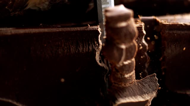 Slicing chocolate bar. Super slow motion