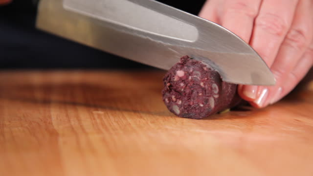 slicing chorizo in equal portions - chorizo stock videos & royalty-free footage