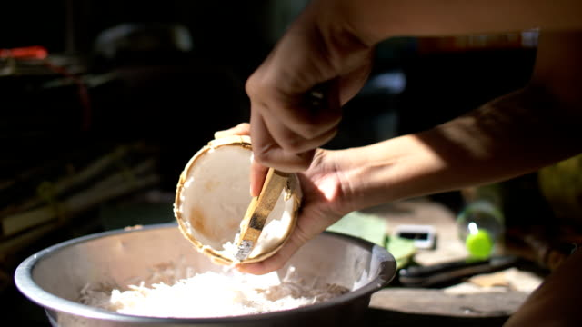 slicing coconut - penknife stock videos & royalty-free footage
