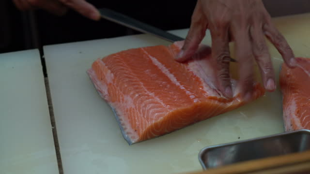 slicing fresh salmon raw