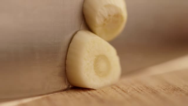 slicing garlic clove - garlic stock videos & royalty-free footage