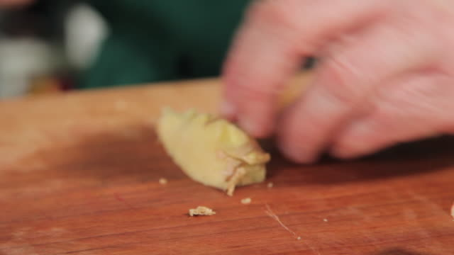 slicing ginger in thin slices - ginger spice stock videos and b-roll footage