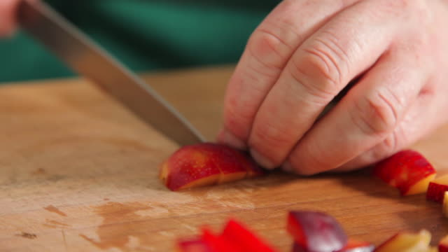 slicing plum in small pieces - plum stock videos & royalty-free footage
