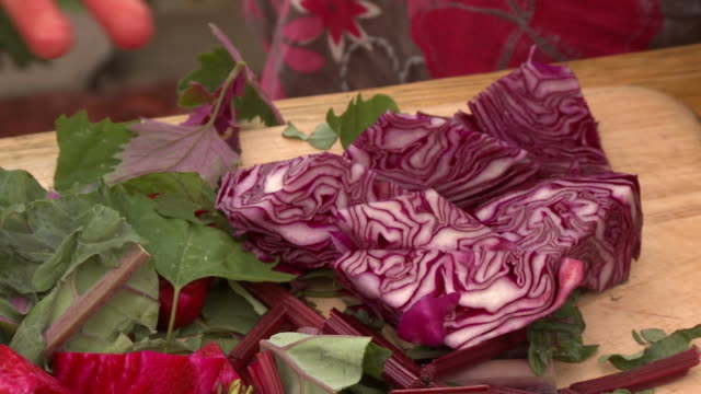 slicing red cabbage and stalks - red cabbage stock videos & royalty-free footage