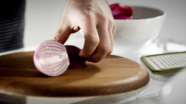 slicing red onion - red onion stock videos & royalty-free footage