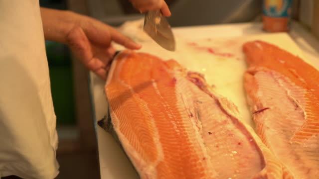 slicing salmon