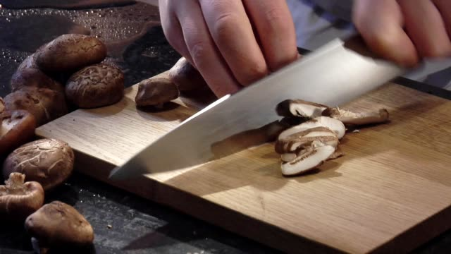 slicing shiitake mushrooms - chopped stock videos & royalty-free footage
