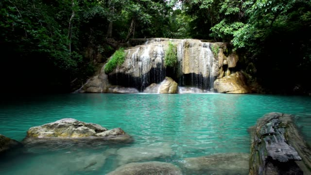 slide dolly waterfall in jungle with beautiful emerald green water. - clima tropicale video stock e b–roll
