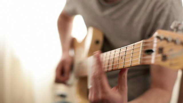 slide guitar with live sound recorded - plucking an instrument stock videos and b-roll footage