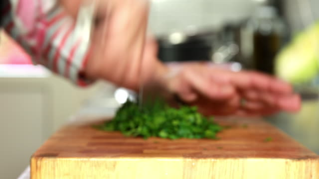 slide on woman chopping parsley - schneiden stock videos & royalty-free footage