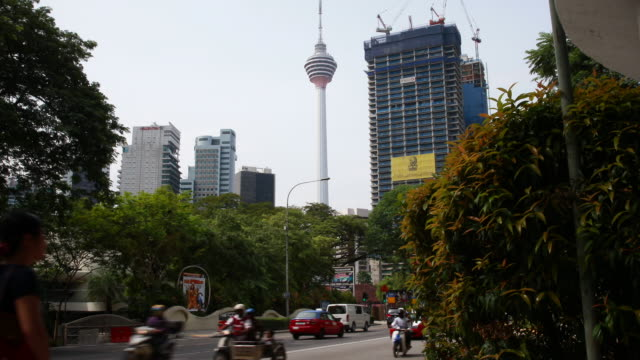 slide to reveal menara kuala lumpur tower from street level - menara kuala lumpur tower stock videos & royalty-free footage