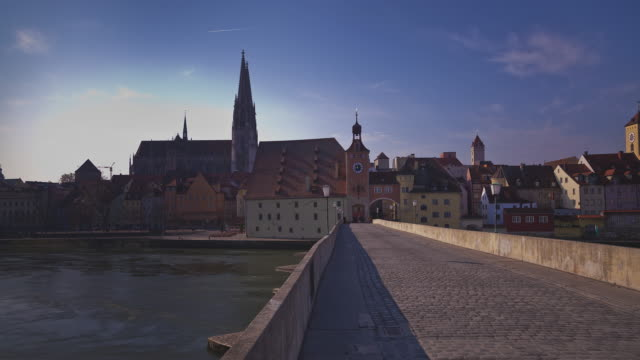 t/l slider of regensburg's / ratisbon's famous cathedral and the stone bridge - regensburg stock videos & royalty-free footage